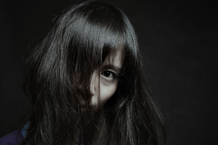 Dark portrait of a pale japanese woman. Halloween and horror Stock Photo
