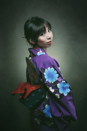bookcover: Beautiful japanese woman in traditional kimono dress . Studio shot Stock Photo