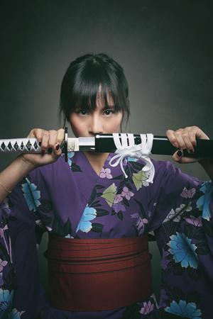 revenge: Japanese woman with samurai sword. Power and revenge