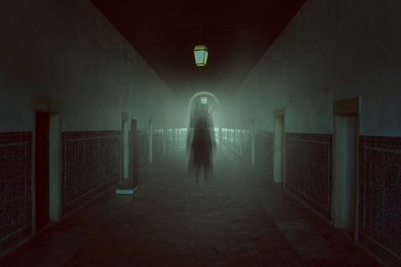 evil girl: Dark evil shadow in haunted building . Halloween and horror tones