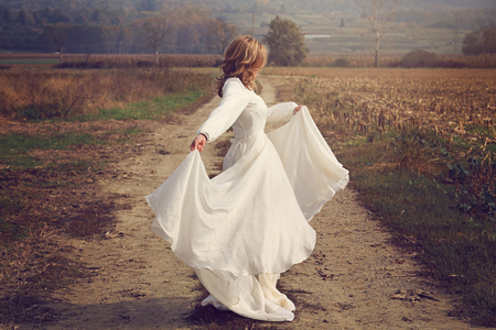 the innocence: Woman with flying bride dress  . Purity and innocence