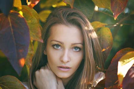 gaze: Beautiful young woman gaze . Autumn leaves portrait