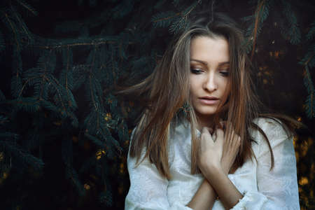 winter woman: Beautiful young woman with sad expression . Loneliness and melancholy