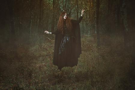 levitation: Powerful forest witch levitation . Dark fantasy and magic