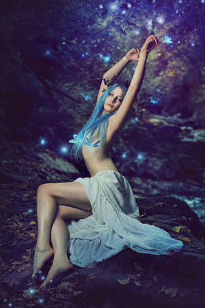 Queen of the fairies among magical butterflies . Fantasy and surreal Stock Photo