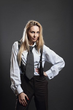 tough woman: Beautiful woman in business suit . Bold and smart concept