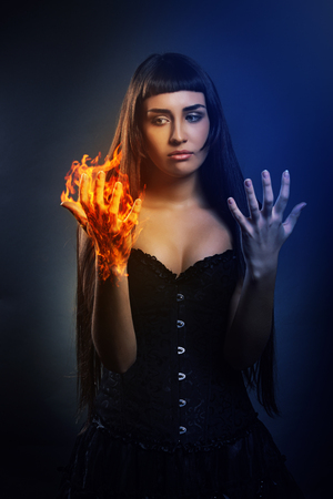 mage: Young woman discovering her new superhero power . Fantasy and magic