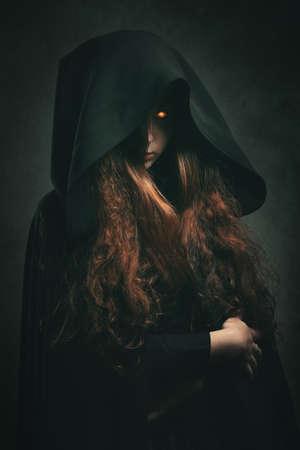 Robe: Fire witch with black robe . Dark fantasy portrait Stock Photo