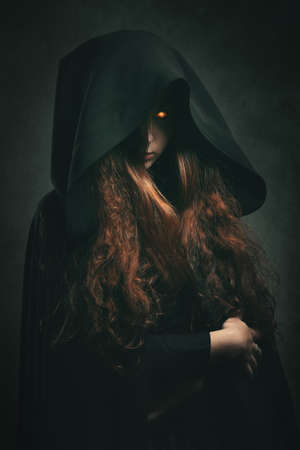 Fire witch with black robe . Dark fantasy portrait Stock Photo