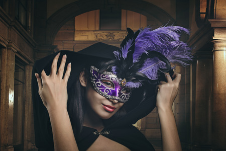 mysterious woman: Mysterious woman with venetian mask. Carnival and fantasy