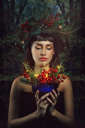 forest wood: Beautiful woman with magical cup of the forest .Winter and fantasy