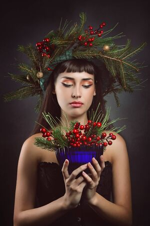 heathen: Beautiful woman with cup full of berries .Winter and fantasy