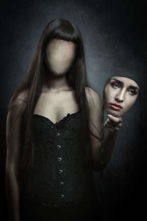 Dark woman without a face . Horror and concept Stock Photo