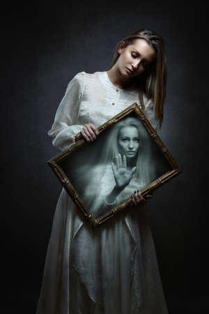 Young woman soul imprisoned inside magical mirror . Dark fantasy and surreal