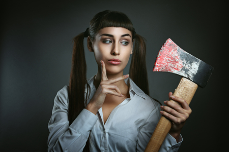 funny people: Dangerous woman with axe full of blood. Funny and amazed expression
