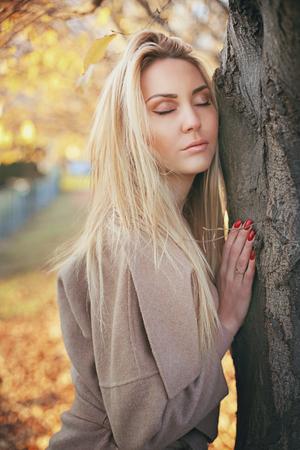 seasonal: Beautiful blond woman relaxing outdoor. Seasonal colors