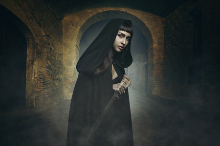 dark alley: Dark beautiful thief in a stone village . Fantasy and halloween concept