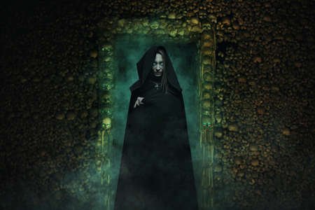 Dangerous vampire in catacombs full of skulls and bones . Horror and fantasy
