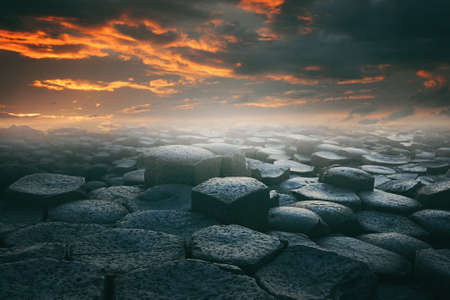 photomanipulation: Dramatic cloudscape and hexagonally stone beach . Surreal and fantasy landscape