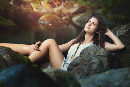 purity: Young woman in a fantasy stream . Purity and innocence Stock Photo