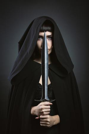 assassin: Hooded beautiful assassin. Dark fantasy