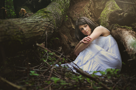 surreal: Beautiful woman in mother nature cradle. Ethereal and fantasy