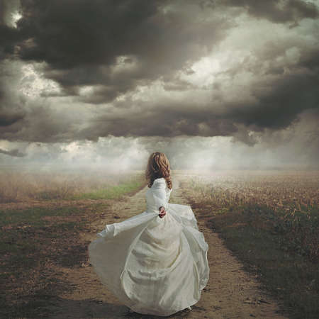 realm: Woman dancing in desolate road. Dramatic and surreal cloudscape