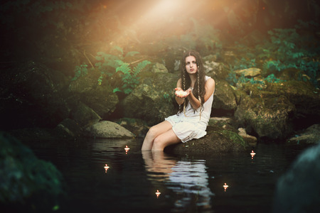 spirits: Beautiful nymph in forest pond. Fantasy and romantic concept Stock Photo