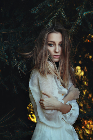 dark forest: Beautiful sad woman . Purity and melancholy Stock Photo
