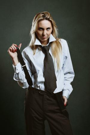 tough: Beautiful woman dressed like businessman . Tough expression