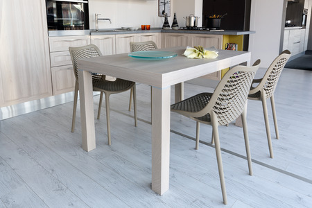 kitchen furniture: Modern style kitchen in cream and grey color . Furniture store