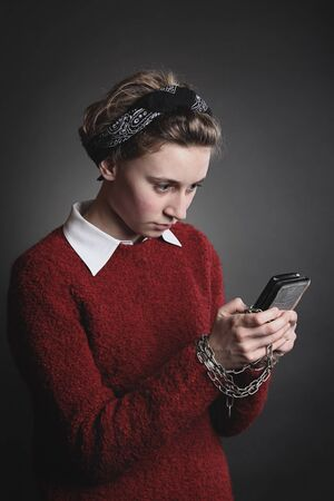 Smartphone dependency . Teenage girl with obsessed eyes