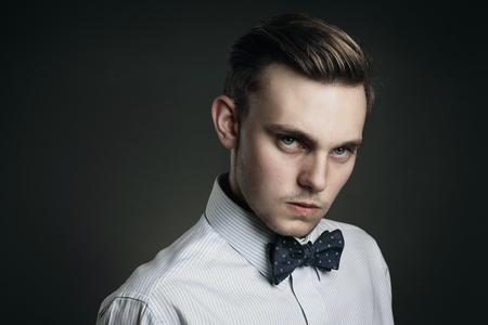 steely: Handsome young man with cold gaze . Hard hearted conceptual