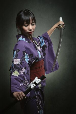 bookcover: Woman in traditional kimono with samurai sword Stock Photo