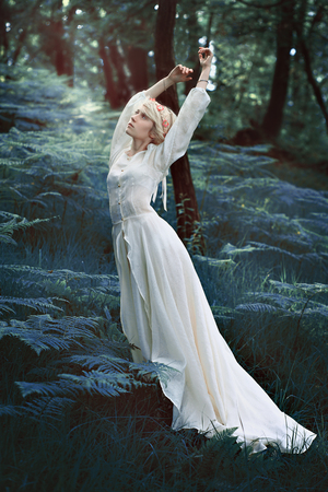 white woman: Fairytale woman dancing in magical forest. Fantasy concept Stock Photo