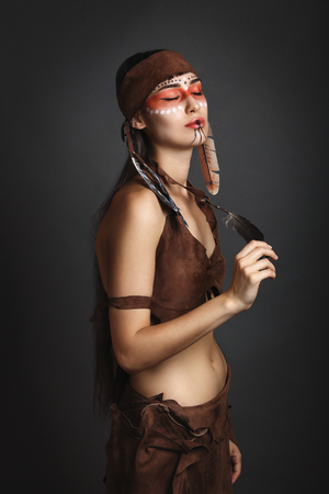 squaw: Beautiful squaw with eyes closed. Native american costume