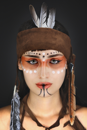 cherokee indian: Beauty portrait of a woman . Native american make up Stock Photo
