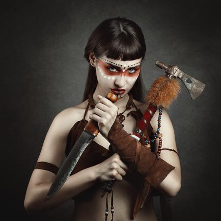 gaze: Deadly gaze from dark native warrior . Studio portrait Stock Photo