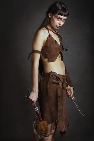 Wild native female warrior ready to fight. Studio shot Stock Photo