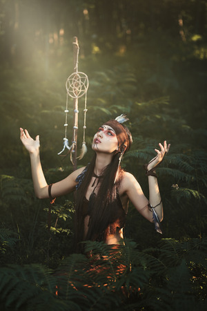 indigenous medicine: Shaman praying to the great Spirit in the forest Stock Photo