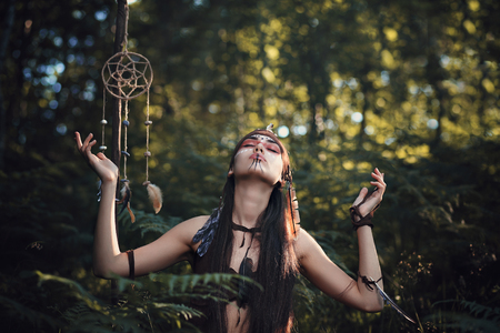 Shaman looking for inspiration from mother Earth. Soul and spirit