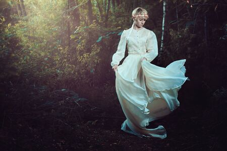 fairytale: Young woman in dreamy fairytale forest