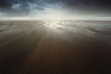 surreal: Dramatic sandy beach with dark cloudscape . Surreal background