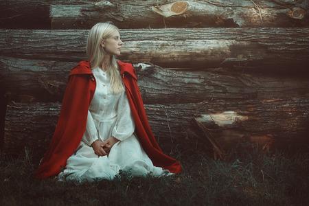 cloak: Blond woman with red hooded cloak. Fine art portrait
