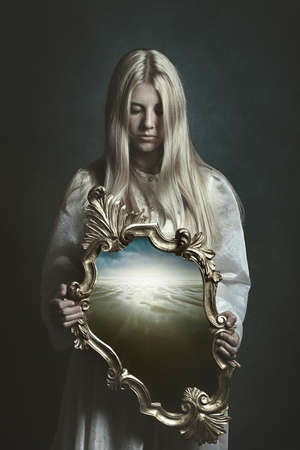 Woman holding magical mirror. Imagination and surreal