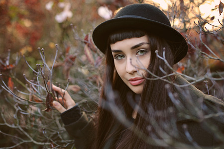autumn colors: Beautiful girl with hat. Autumn colors portrait