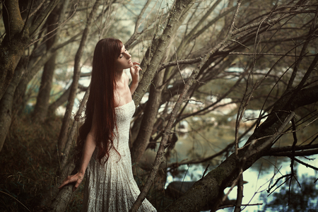 Beautiful woman with vintage dress.  Fine art portrait in the woods
