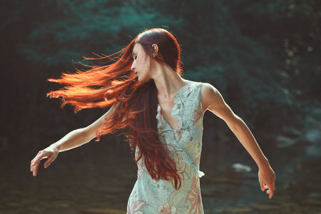 light hair: Woman with beautiful blowing hair. Outdoor light