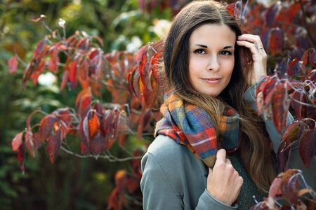 Autumn portrait of beautiful young woman with scarf Standard-Bild