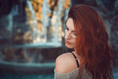 Autumn colors fashion portrait. Red hair woman